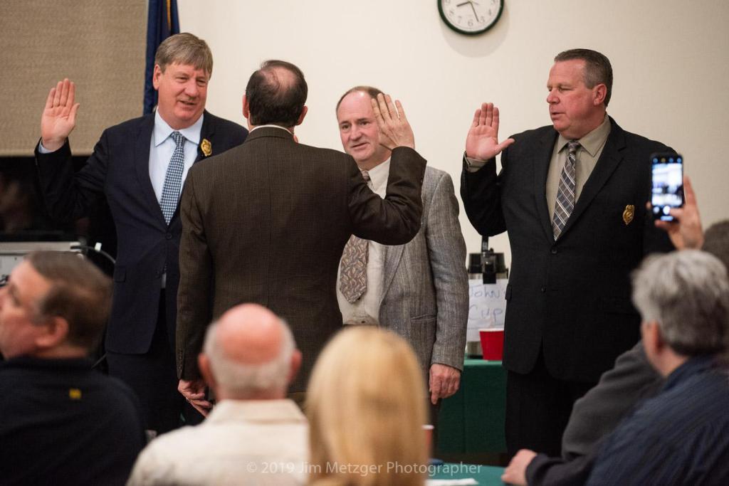 Mayor Peter Swiderski swears in the new chiefs.